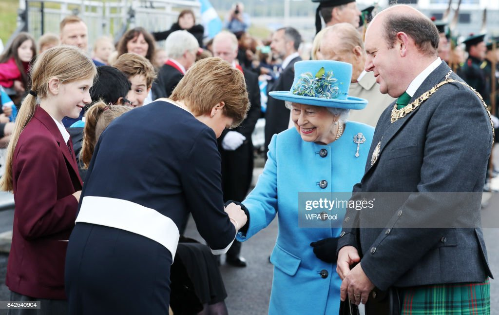 Queen Elizabeth II is greeted by First Minister Nicola Sturgeon during the official opening ceremony of the Queensferry Crossing, on September 4, 2017 in South Queensferry, Scotland. Scotland's newest road bridge which began construction in 2011, crosses the Firth of Forth near Edinburgh. The crossing is the world's longest three tower cable stayed bridge.