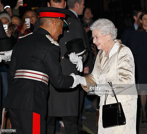 Queen Elizabeth II is greeted by Kenneth Olisa LordLieutenant of Greater London as she attends the Gold Service Scholarship awards ceremony at...