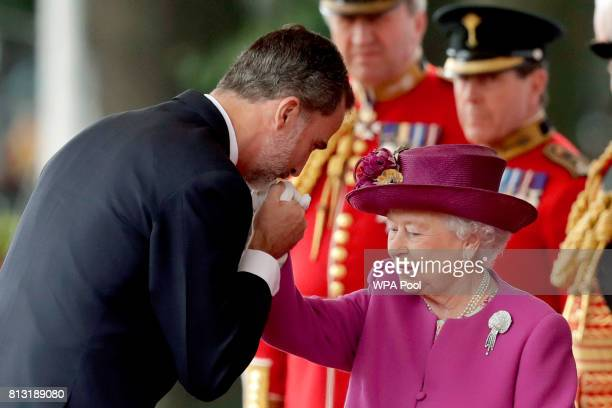 Queen Elizabeth II is greeted by King Felipe VI of Spain at a Ceremonial Welcome on Horse Guards Parade on July 12 2017 in London England This is the...