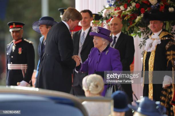 Queen Elizabeth II is greeted by King WillemAlexander of the Netherlands during a ceremonial welcome at Horse Guards Parade on October 23 2018 in...