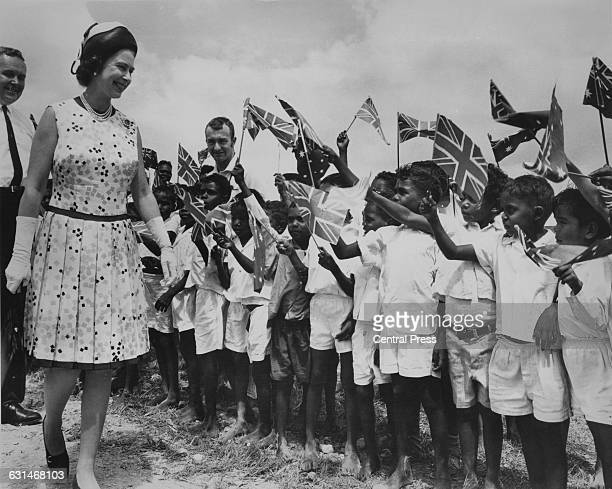 Queen Elizabeth II is greeted by local children at Cooktown in Queensland during her tour of Australia 22nd April 1970 She is there in connection...