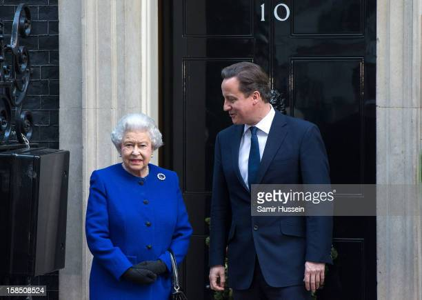 Queen Elizabeth II is greeted by Prime Minister David Cameron as she arrives at Number 10 Downing Street to attend the Government's weekly Cabinet...