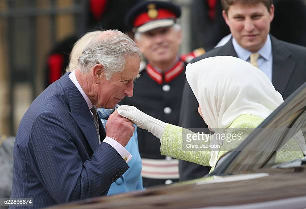 Queen Elizabeth II is greeted by Prince Charles Prince of Wales as she attends a becaon lighting ceremony to celebrate her 90th birthday on April 21...