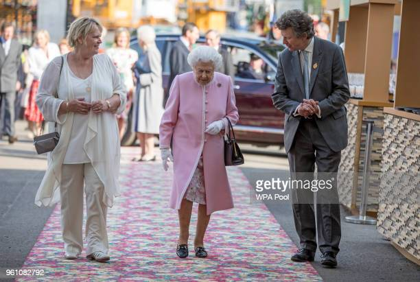 Queen Elizabeth II is greeted by Sue Biggs and Sir Nicholas Bacon of the RHS at the Chelsea Flower Show 2018 on May 21 2018 in London England