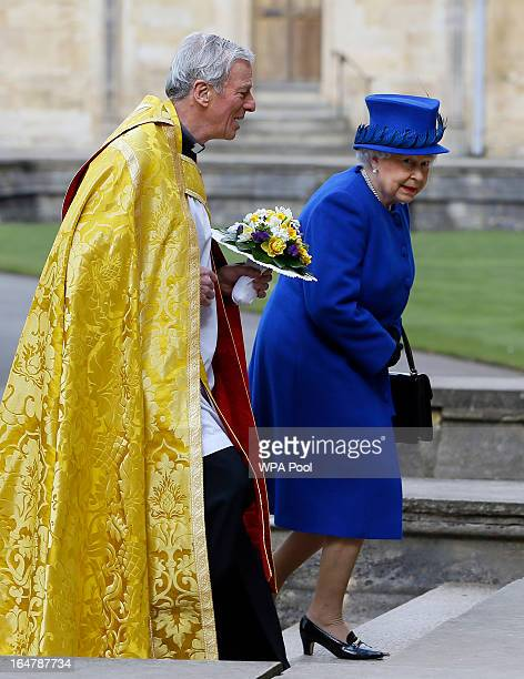 Queen Elizabeth II is greeted by The Dean Christopher Lewis as she arrives to attend the Maundy service at Christ Church Cathedral on March 28 2013...