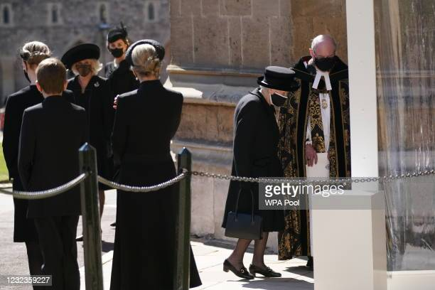 Queen Elizabeth II is greeted by the Right Reverend David Conner, Dean of Windsor as she arrives for the funeral of Prince Philip, Duke of Edinburgh...
