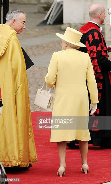 Queen Elizabeth II is greeted by The Right Reverend Dr John Hall Dean of Westminster as she arrives to attend the Royal Wedding of Prince William to...