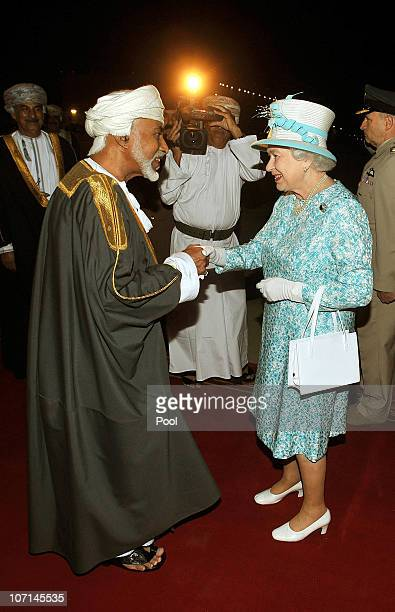 Queen Elizabeth II is greeted by the Sultan of Oman His Majesty Qaboos bin Said Al Said after arriving from the UAE on November 25 2010 in Muscat...