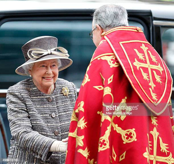 Queen Elizabeth II is greeted by The Very Reverend Dr John Hall Dean of Westminster as she attends a service to mark the Inauguration of the Tenth...