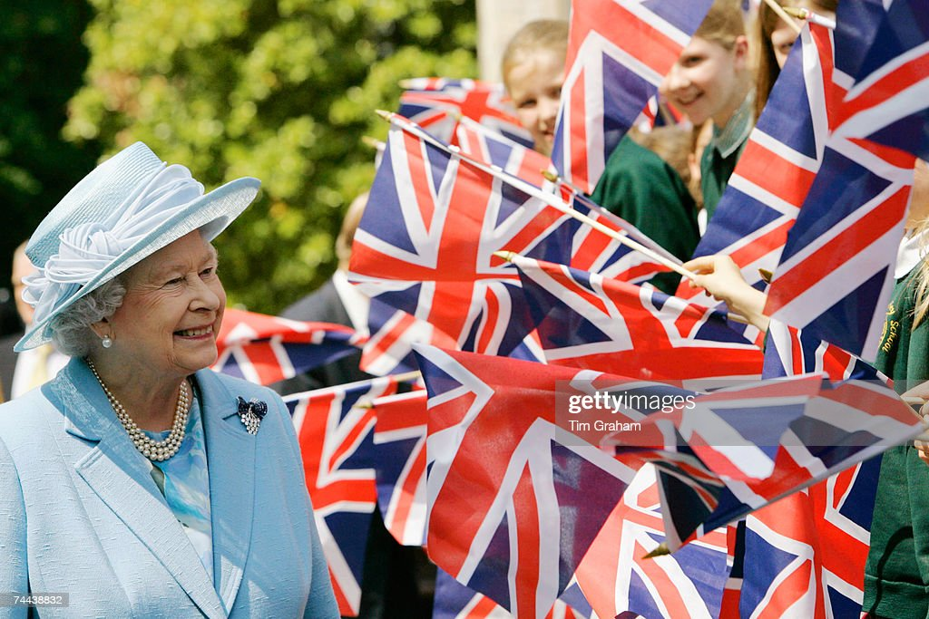 Queen Elizabeth II is greeted by Union Jack flags during a walkabout on June 8, 2007 in Romsey, England.