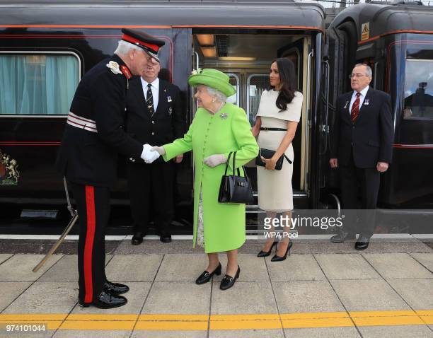 Queen Elizabeth II is greeted with Meghan Duchess of Sussex as they arrive by Royal Train at Runcorn Station to open the new Mersey Gateway Bridge on...