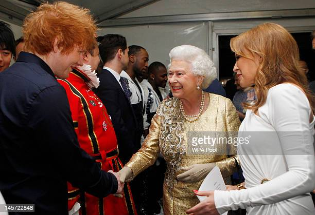 Queen Elizabeth II is introduced to Ed Sheeran by Kylie Minogue backstage after the Diamond Jubilee Buckingham Palace Concert on June 04 2012 in...