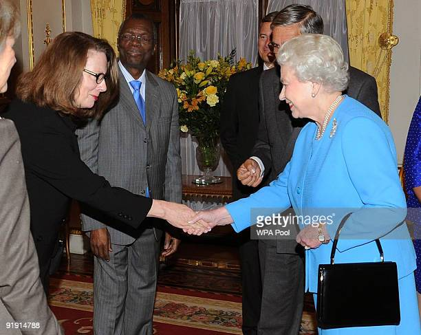 Queen Elizabeth II is introduced to Her Honour Justice Susan Kiefel during a reception for Overseas Chief Justices at Buckingham Palace on October 15...