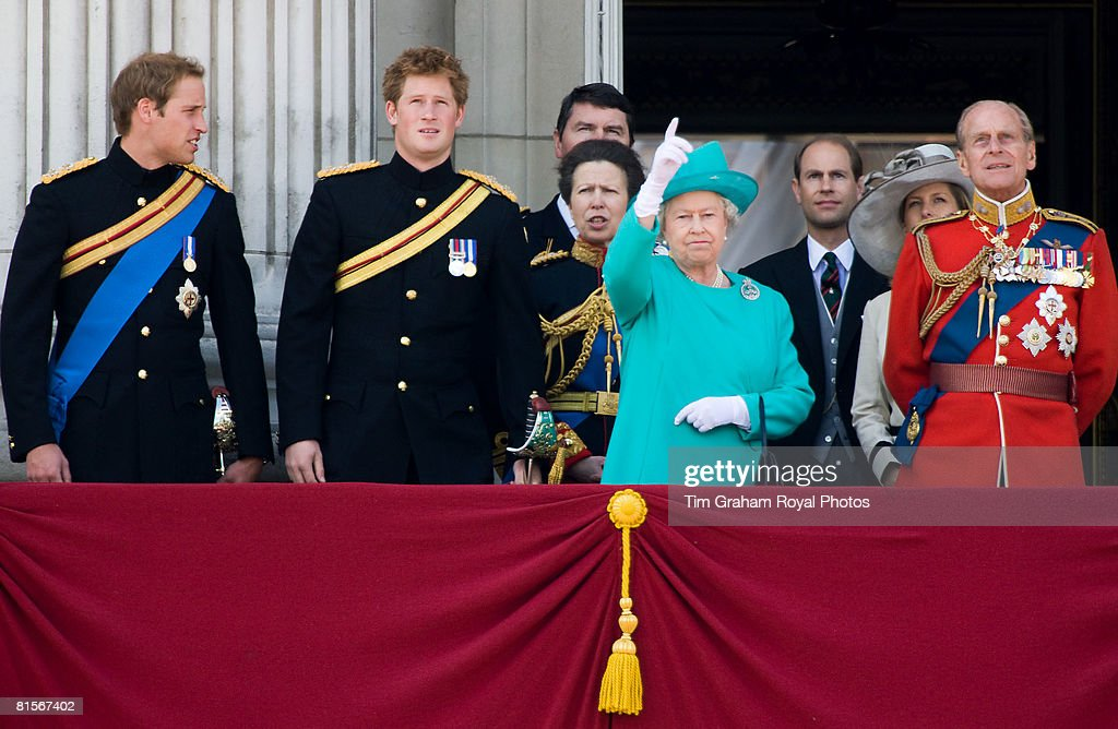 Queen Elizabeth II (C) is joined by Prince Philip, Duke of Edinburgh (R), Prince William (L) and Prince Harry (2nd L) on the balcony of Buckingham Palace as they look up to watch a flypast after Trooping The Colour on June 14, 2008 in London, England. The ceremony is Queen Elizabeth II's annual birthday parade and dates back to the time of Charles II in the 17th Century when the Colours of a regiment were used as a rallying point in battle.