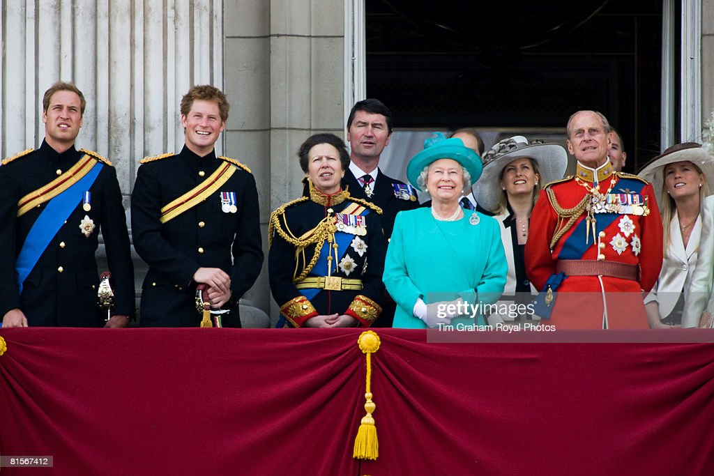 Queen Elizabeth II is joined by Prince Philip, Prince William, Prince Harry, Princess Anne and others on the balcony of Buckingham Palace to watch a flypast after Trooping The Colour on June 14, 2008 in London, England.