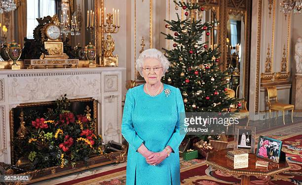 Queen Elizabeth II is pictured prior to the recording of her Christmas Day broadcast to the Commonwealth in the White Drawing Room at Buckingham...