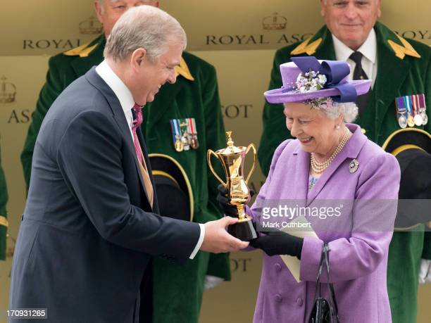 Queen Elizabeth II is presented The Gold Cup by Prince Andrew Duke of York after her horse Estimate won during Ladies Day on Day 3 of Royal Ascot at...