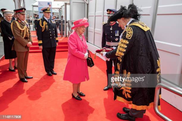 Queen Elizabeth II is presented to the Keys of Portsmouth by the Mayor ahead of the National Commemorative Event commemorating the 75th anniversary...
