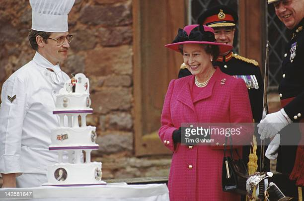 Queen Elizabeth II is presented with a birthday cake by the men of the Royal Welch Fusiliers, during a visit to Powis Castle in Wales, 21st April...