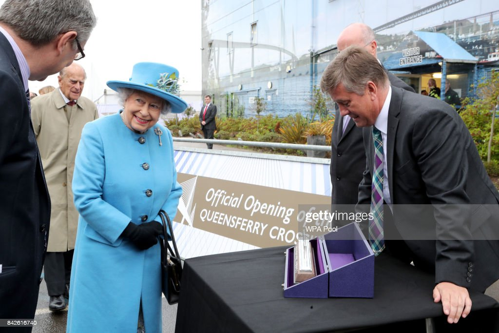 Queen Elizabeth II is presented with a model of the new bridge by Economy Secretary Keith Brown MSP (right) during the official opening of the Queensferry Crossing on September 4, 2017 in South Queensferry, Scotland. Scotland's newest road bridge which began construction in 2011, crosses the Firth of Forth near Edinburgh. The crossing is the world's longest three tower cable stayed bridge.