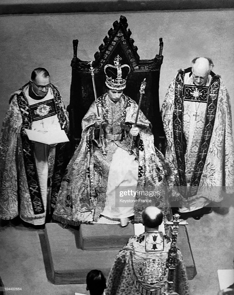 Queen Elizabeth II is seated on the St. EDWARD throne. She is wearing the crown of England which was placed on her head by the Archbishop of Canterbury.