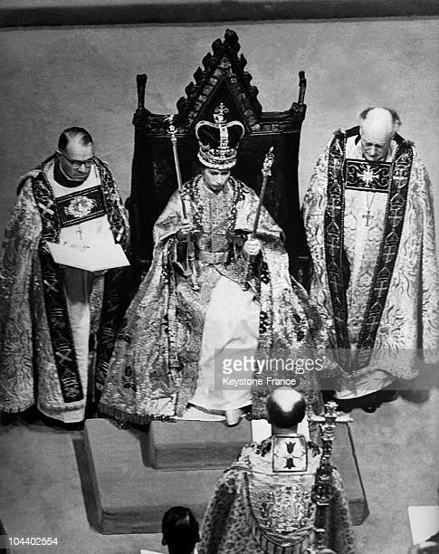 Queen Elizabeth II is seated on the St EDWARD throne She is wearing the crown of England which was placed on her head by the Archbishop of Canterbury