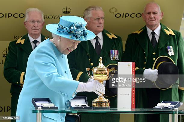 Queen Elizabeth II is seen about to present The Gold Cup during day three of Royal Ascot at Ascot Racecourse on June 19 2014 in Ascot England