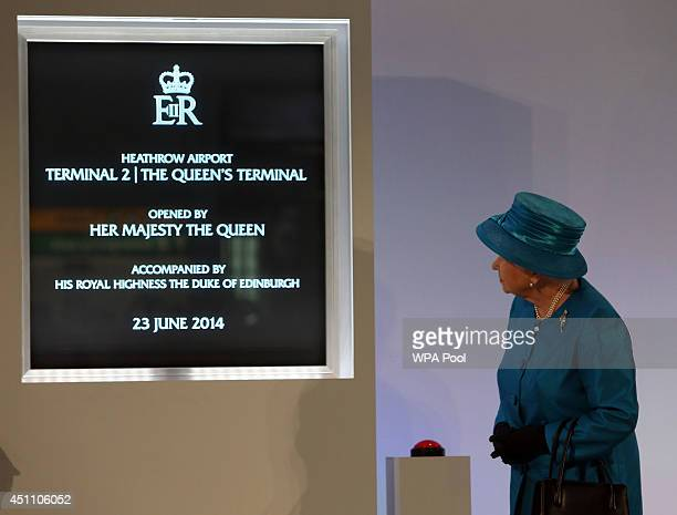 Queen Elizabeth II is seen as she officially opens the new Terminal 2 The Queen's Terminal at Heathrow Airport on June 23 2014 in London England