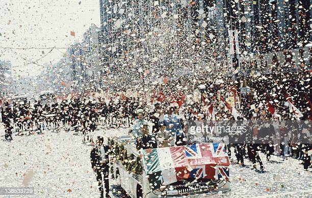 Queen Elizabeth II is showered with confetti during her state visit to Mexico 1975 Her vehicle carries the flags of Mexico and the UK