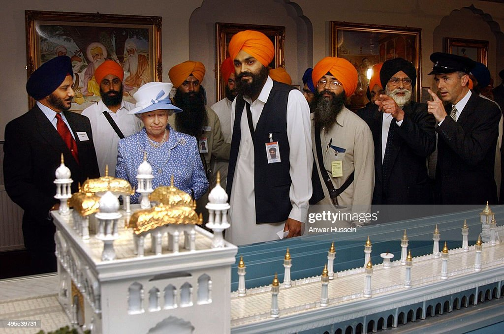 Queen Elizabeth II is shown a model of The Golden Temple based in Amritsar during a visit to the Sikh Gurdhwara Temple on August 1 2002 in Leicester..