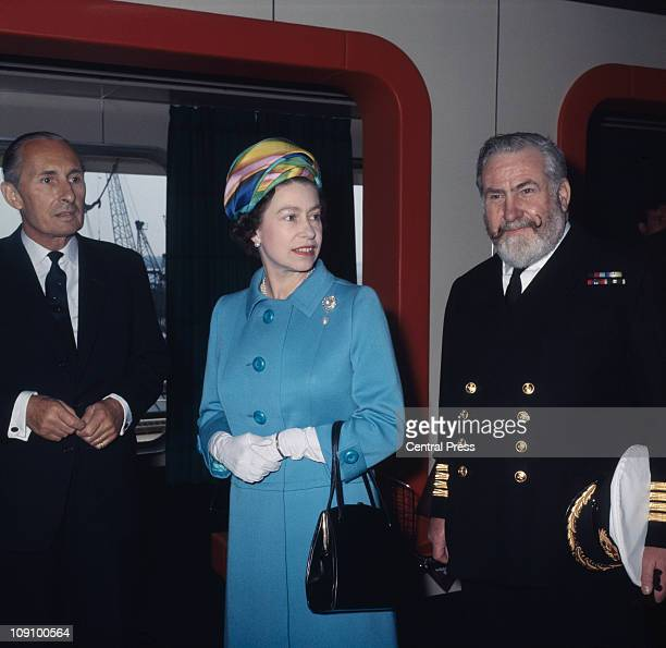 Queen Elizabeth II is shown around the new Cunard liner 'RMS Queen Elizabeth 2' or 'QE2' at Southampton by Commodore William Warwick and Cunard...