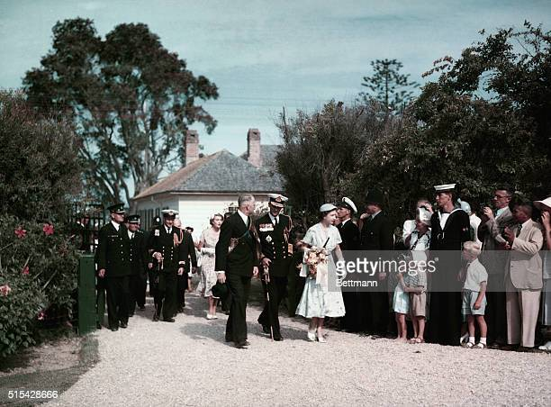Queen Elizabeth II is shown here on a Royal Tour The Queen is leaving the Treaty House in Waitangi She is accompanied by Prince Phillip and her...
