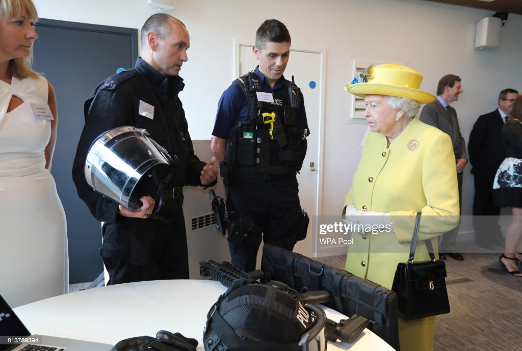Queen Elizabeth II is shown police equipment during the opening of the the new headquaters of the Metropolitan Police Service on July 13, 2017 in London, England.