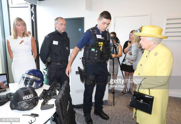 Queen Elizabeth II is shown police equipment during the opening of the the new headquaters of the Metropolitan Police Service on July 13 2017 in...
