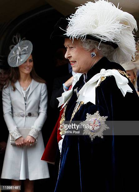 Queen Elizabeth II is watched by Catherine, Duchess of Cambridge whilst walking in the procession for the annual Order of the Garter Service at St...