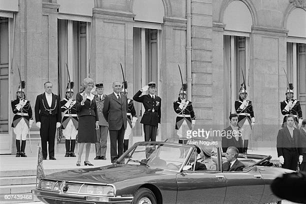 Queen Elizabeth II is welcomed at the Elysee Palace by French President Georges Pompidou and his wife Claude Cahour
