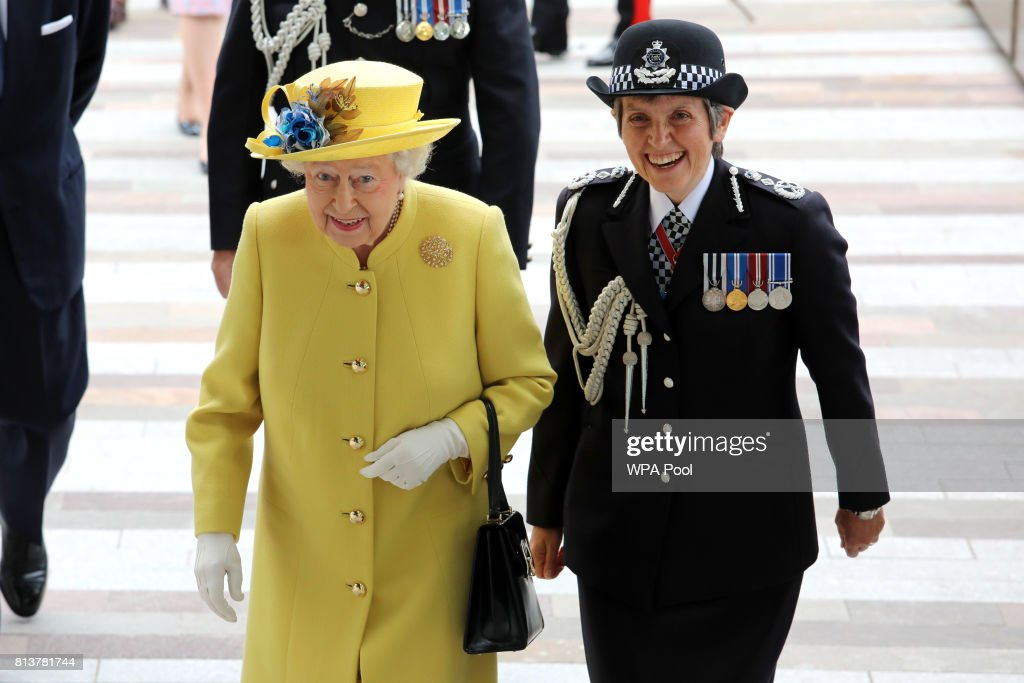 Queen Elizabeth II (L) is welcomed by Commissioner of the Metropolitan Police Cressida Dick during the opening of the the new headquaters of the Metropolitan Police Service on July 13, 2017 in London, England.