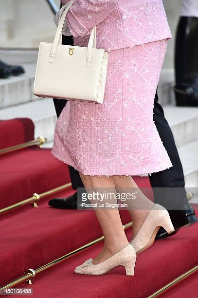 Queen Elizabeth II is welcomed by French President Francois Hollande at the Elysee Presidential Palace as part of a bilateral meeting during an...