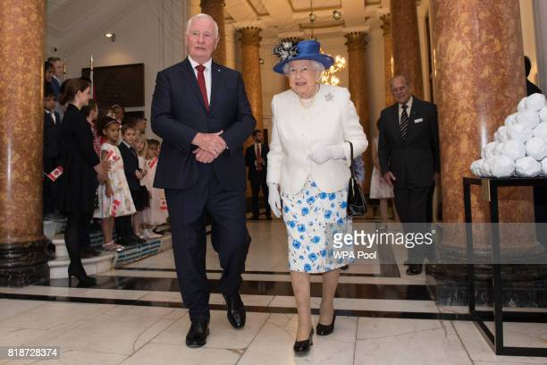 Queen Elizabeth II is welcomed to Canada House by Canada Governor General David Johnston for her visit to Canada House on July 19 2017 in London...