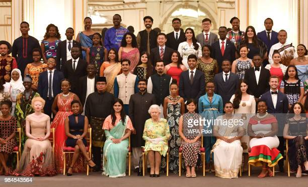 Queen Elizabeth II joins some of the Queen's Young Leaders who received their award at the Queen's Young Leaders Awards Ceremony at Buckingham Palace...