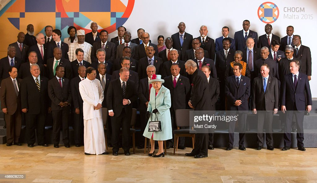 Queen Elizabeth II joins (Front row, left to right) Sri Lanka president Maithriipala Sirisena, Malta Prime Minister Joseph Muscat and Commonwealth Secretary General Kamalesh Sharma as she arrives for the family photo of the Commonwealth Heads of State at the CHOGM opening ceremony at the Mediterranean Conference Centre on November 27, 2015 near Valletta, Malta. Queen Elizabeth II, The Duke of Edinburgh, Prince Charles, Prince of Wales and Camilla, Duchess of Cornwall arrived yesterday to attend the Commonwealth Heads of State Summit.