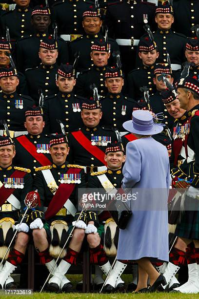 Queen Elizabeth II joins The Argyll Sutherland Highlanders 5th Battalion Royal Regiment of Scotland on June 28 2013 in Canterbury Kent England