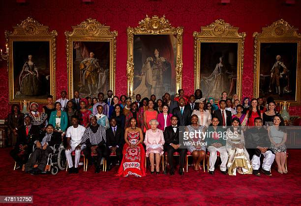 Queen Elizabeth II joins Young Leaders from across the Commonwealth at Buckingham Palace, Alain Nteff , Samuel Karuita , Karuna Rana , Isaiah Owolabi...
