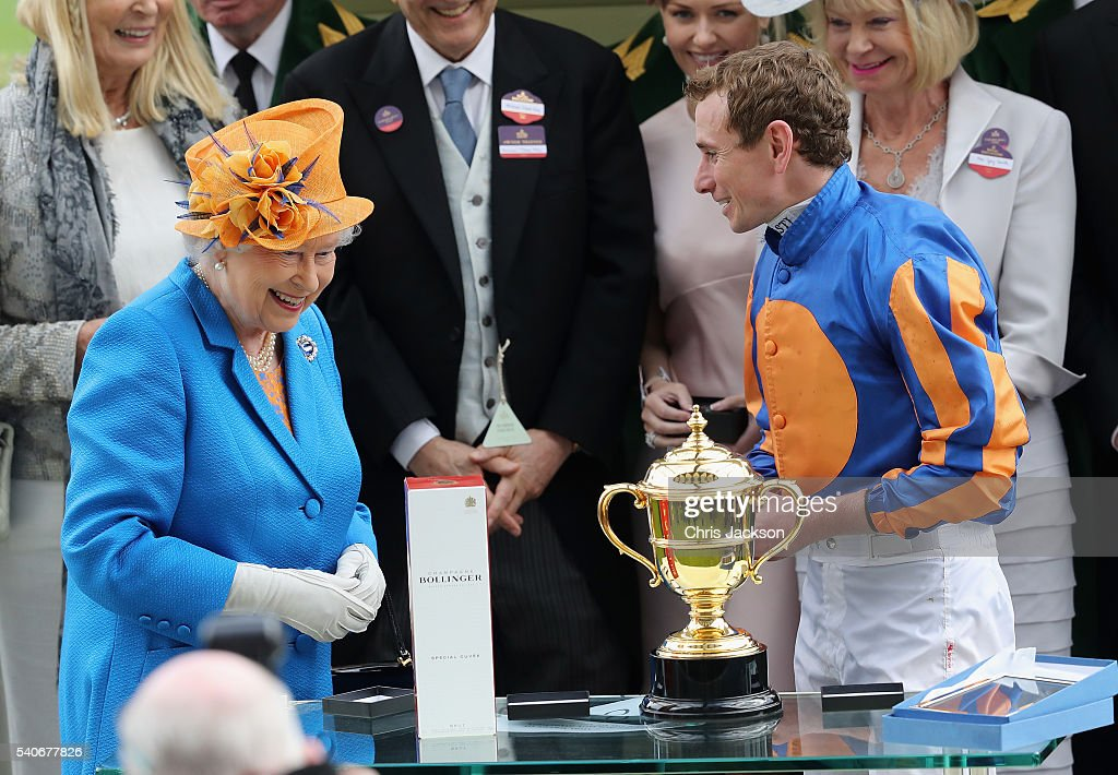 Queen Elizabeth II jokes with Gold Cup winning jockey Ryan Moore in the parade ring as she attends the third day of Royal Ascot at Ascot Racecourse on June 15, 2016 in Ascot, England.