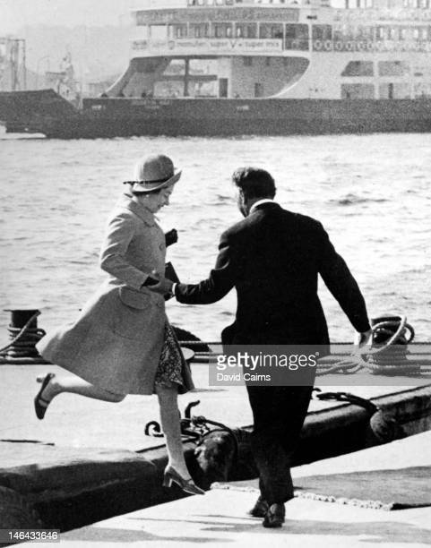 Queen Elizabeth II jumps ashore from a barge after disembarking from the Royal Yacht 'Brittania' during a State Visit to Turkey 23rd October 1971