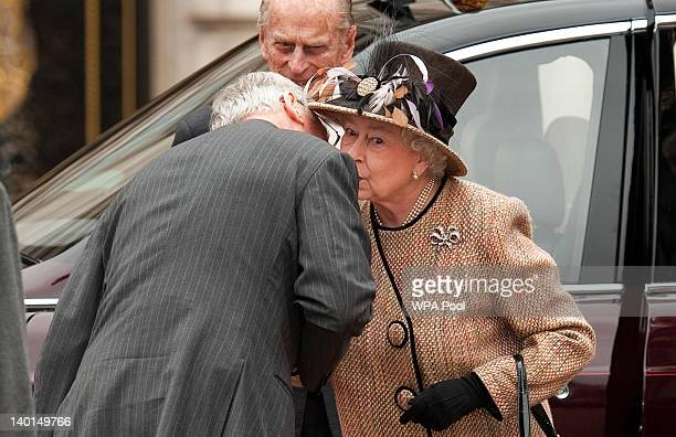 Queen Elizabeth II kisses her cousin Prince Richard, Duke of Gloucester as she and Prince Philip, Duke of Edinburgh arrive at the central gates of...