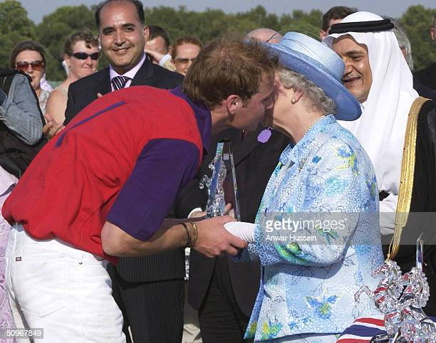 Queen Elizabeth II kisses her grandson, Prince William, as they attend a polo match at Windsor Great Park following the second day of Royal Ascot at...