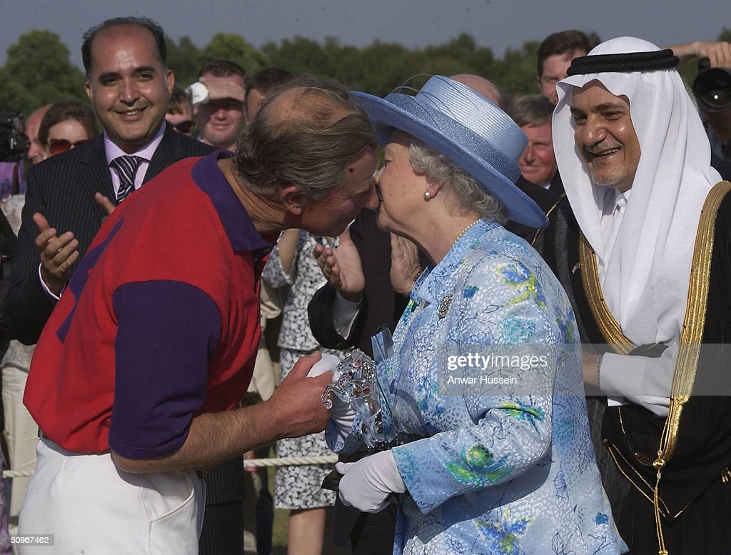 Queen Elizabeth II kisses her son Charles the Prince of Wales, at a polo match at Windsor Great Park following the second day of Royal Ascot on June 16, 2004 in Windsor, England.