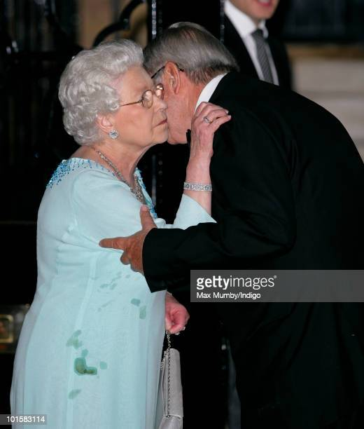 Queen Elizabeth II kisses King Constantine of Greece goodbye as she leaves his 70th birthday party at Crown Prince Pavlos of Greece's residence on...