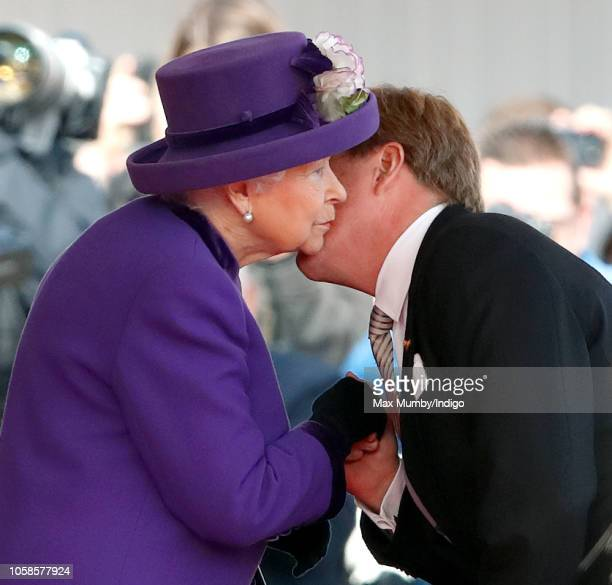 Queen Elizabeth II kisses King WillemAlexander of the Netherlands during a ceremonial welcome at Horse Guards Parade as The King and Queen of the...